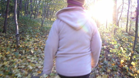 Women walk in an alley of the park in a fall cold day 174 Footage