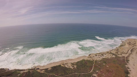 360 degree panoramic aerial view of Praia de Santa Cruz - Portugal Footage