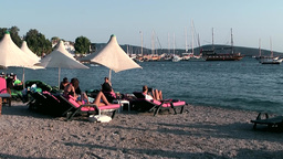 Turkey the Aegean Sea Bodrum 039 people enjoy last sunbeams at beach Footage