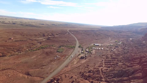 Aerial of cars driving on a red sand road, near marble canyon, in Arizona, in Footage