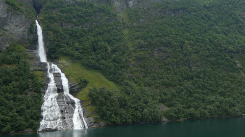 passing waterfall in geiranger fjord Live Action