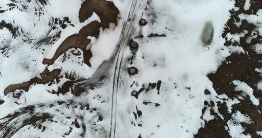 Winter road, Cinema 4k tilt up aerial on a snowy sand route revealing a icy sand Footage