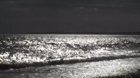 Waves run ashore. The shimmering waves in the sun Footage
