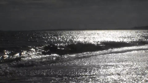 Waves run ashore. The shimmering waves in the sun. Video shot backlight Footage