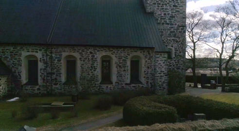 Kemio church, Aerial rising tilt view of a old church, on a sunny spring day, in Footage