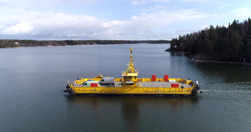 Skåldö cable ferry, Cinema 4k aerial backing out sideway view following a yellow Footage