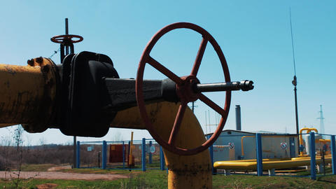 Oil and natural gas. Pipeline with a large shut-off valve. A station for Footage