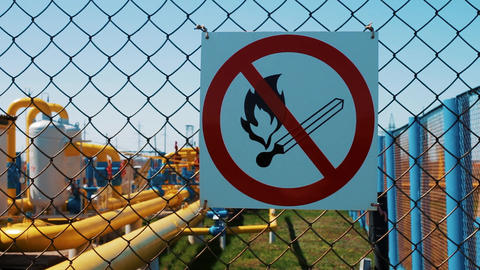 Plant for processing natural gas. Warning of fire hazard on the fence Footage
