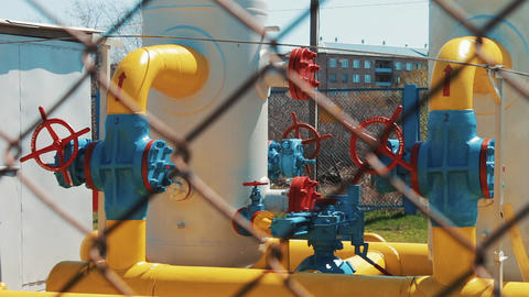 Gas pipe at the station. Pumps for pumping oil and gas. Check valves with a Footage