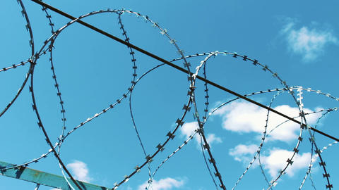 Fence with barbed wire. Closed territory protection Footage