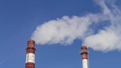 Air Pollution From Industrial Enterprises. Large pipes throwing smoke in the sky Footage