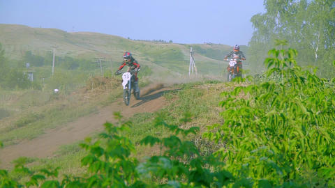 Low angle shot of motocross rider landing after jump in slow motion. Beautiful Footage