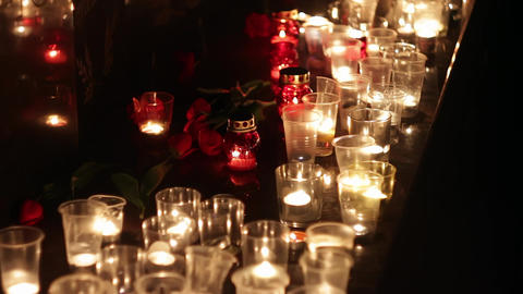 Flowers and candles at the memorial in honor of the victims of the victims of Footage