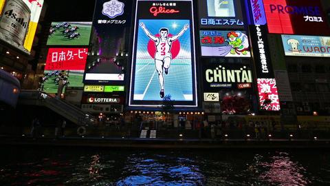 Dotonbori district with famous Glico man at night, Osaka, Japan Footage