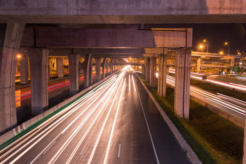 Light trail on highway at night フォト