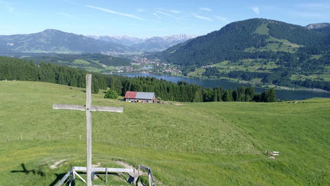 Drone flying in Allgäu German Alps and over Großer Alpsee Lake Footage