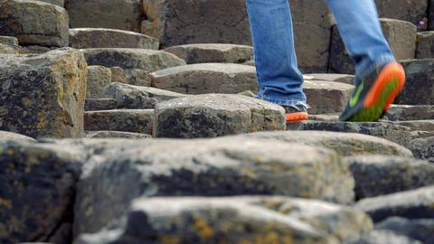 Tourist Walking On Giant Causeway, Northern Ireland - Graded Version Footage