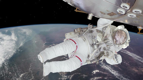 Astronaut working on space station above the Earth. Astronaut Spacewalk, waving Animation