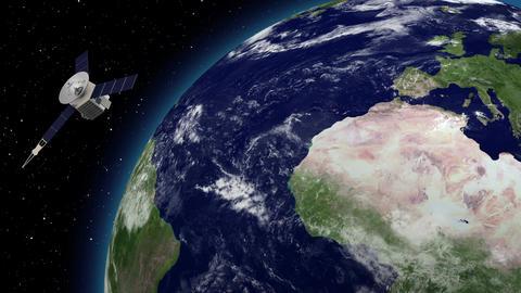 Satellite revolving over earths atmosphere 画像