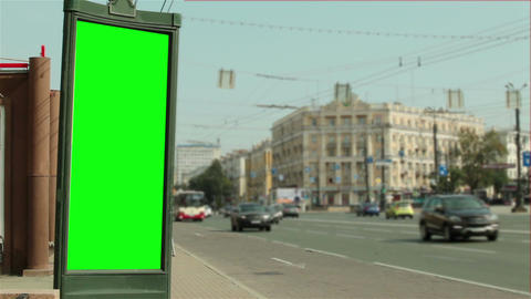 Advertising design with a green background near the road Archivo