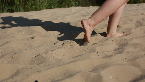 A man goes barefoot on the sand Footage
