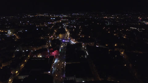 Flying above big european city at night Footage