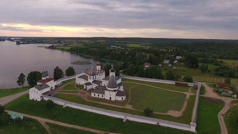 Aerial View of a picturesque ancient monastery on the shore of the lake on the Archivo