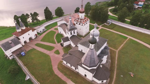 Aerial View of a picturesque ancient monastery on the shore of the lake Footage