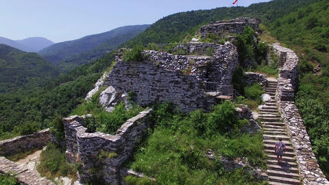 Flying over ancient Christian Fortress in the Mountains Footage