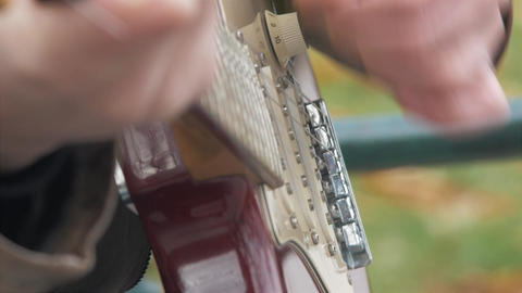 Man playing electric guitar outside close up 4K stock video Footage