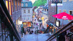 Quebec City, Canada - May 31, 2017: Colorful cobblestone street during blue hour Footage