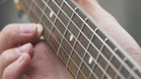 Playing electric guitar 4K stock footage. Close up shot, man's fingers Footage