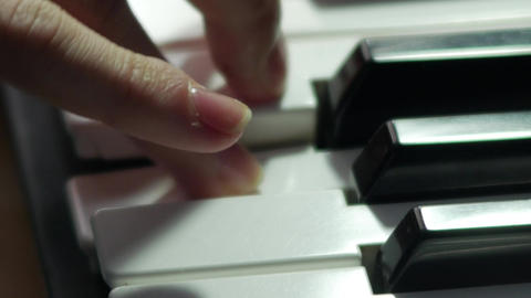 Synthesizer macro fingers playing keys 2160p UHD 4K stock video professional Footage