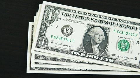 Hundred dollar bills fall on a black table Footage