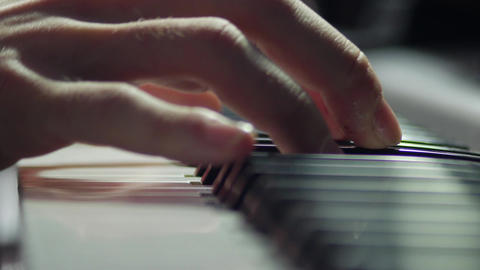 Playing symphonic music piano closeup stock video Footage