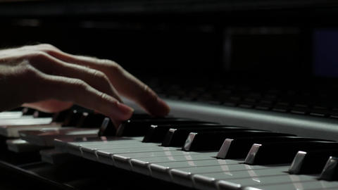 Playing piano synthesizer in a studio closeup stock video 2160p UHD 4K Footage