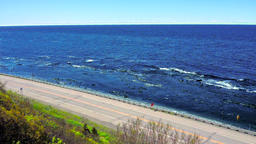 Aerial view of road and ocean or Saint Lawrence river in the Gaspe Peninsula, Footage