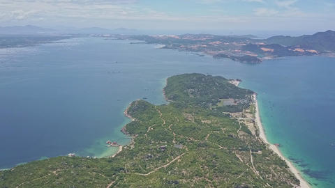 Drone Flies above Green Peninsula with Roads to Open Ocean Footage