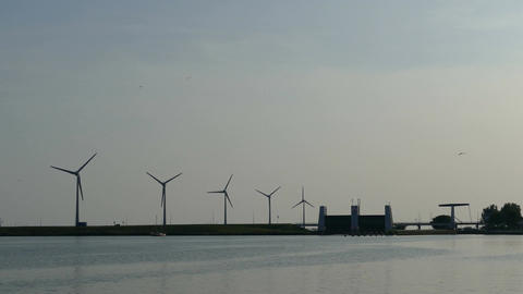 Wind farm at sunset in Ijselmeer at Enkhuizen fishing village Footage