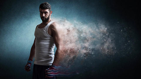 Muscular male boxer standing over dark background particles effect Animación