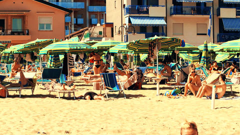 LIDO DI JESOLO, ITALY - AUGUST 8, 2017. Big crowded sandy beach on summer Footage