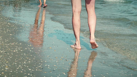 Legs of a man walking along the seaside Live Action