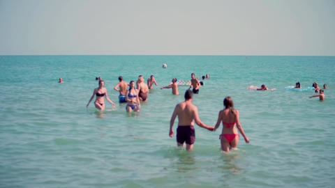 LIDO DI JESOLO, ITALY - AUGUST 8, 2017. People bathing in the sea, summer Footage