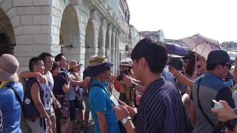 VENICE, ITALY - AUGUST 8, 2017. Asian tourists near famous San Marco square Footage