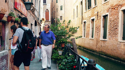 VENICE, ITALY - AUGUST 8, 2017. Venetian canal and pedestrian embankment Footage