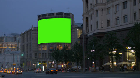 A large billboard, on an ancient building, on a busy street. Green screen Footage