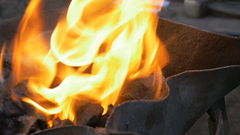 Burning coal in the hearth of a blacksmith Footage