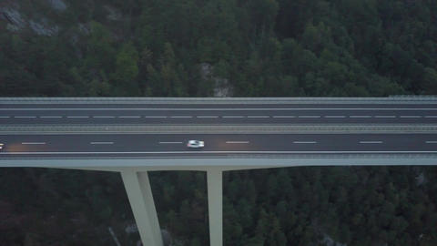 Aerial view of European highway bridge in mountains at dusk Footage