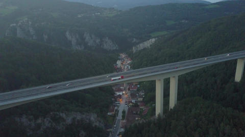Aerial view of Austrian highway bridge above small town in mountains in the Footage