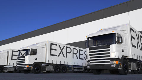Freight semi truck with EXPRESS caption on the trailer loading or unloading Footage